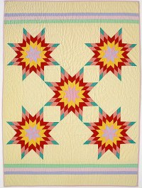 "Mary Youngman (Sioux) sewed for the Levi Strauss Company during World War II. Here five-star pattern in ""Indian Five Star"" (1968-1975) became her signature design. ""This is the way these colors speak to me."" In describing her work as a quilter at the end of her life, she said, ""Now, my eyesight is almost gone. I am sad not to be able to quilt anymore."""